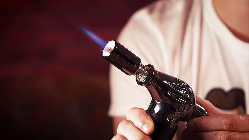 regler flamme briquet à molette